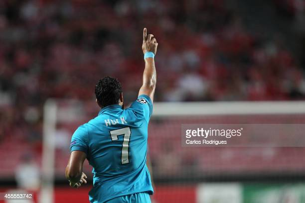 Zenit's forward Hulk celebrating scoring Zenit's first goal during the Champions League match between Benfica and Zenit on September 16 2014 in...