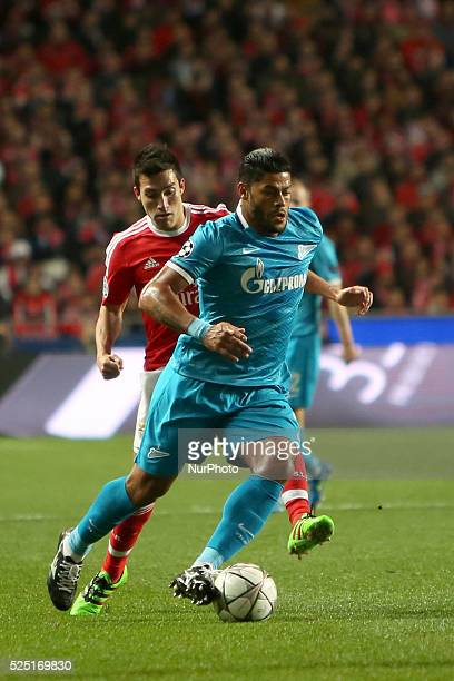 Zenit's forward Hulk vies with Benfica's midfielder Nicols Gaitan during the UEFA Champions League round of 16 football match between SL Benfica and...