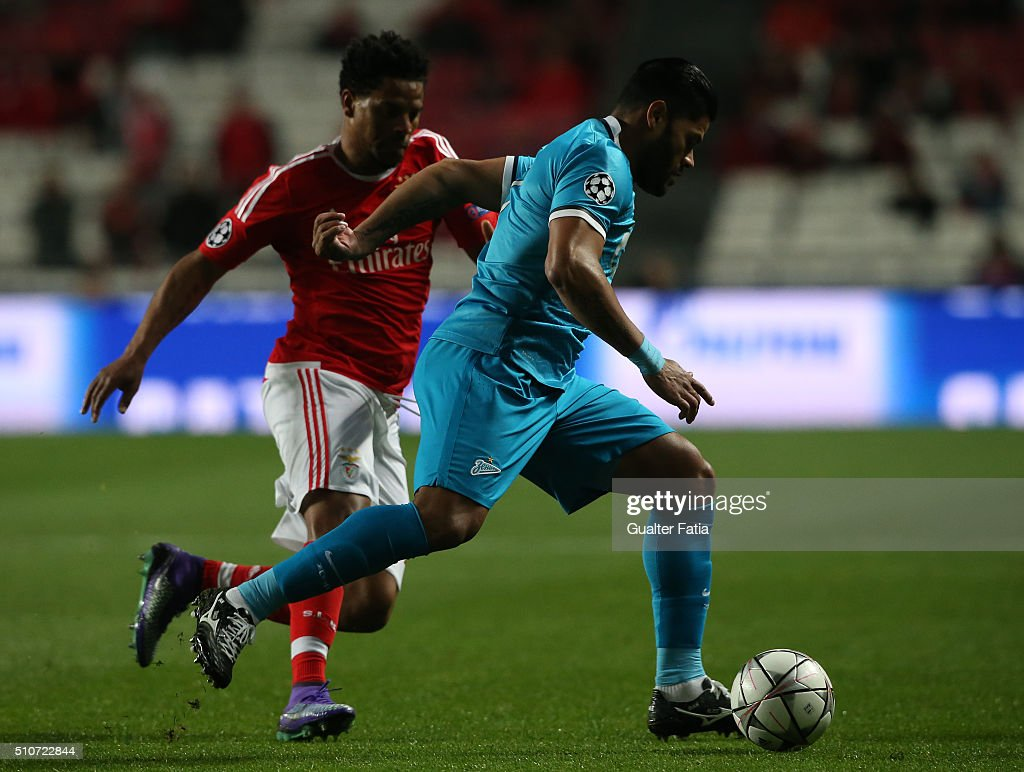 FC ZenitÕs forward Hulk with SL BenficaÕs defender Eliseu in action during the UEFA Champions League Round of 16: First Leg match between SL Benfica and FC Zenit at Estadio da Luz on February 16, 2016 in Lisbon, Portugal.
