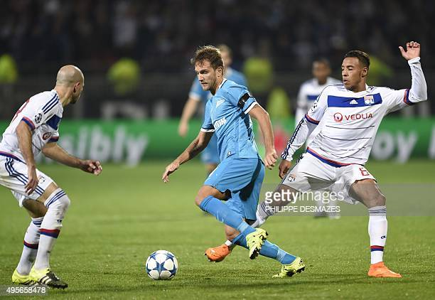 Zenit's Italian defender Domenico Criscito vies with Lyon's French midfielder Corentin Tolisso and Lyon's French defender Christophe Jallet during an...