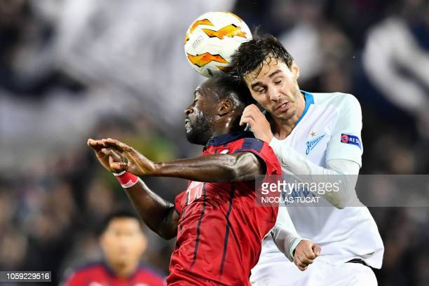Zenit's midfielder Aleksandr Erokhin vies with Bordeaux's French defender Maxime Poundje during the Europa league football match of Group C between...