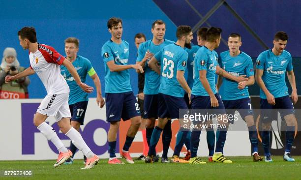 Zenit's players celebrate the opening goal during the UEFA Europa League Group L football match between FC Zenit and FK Vardar in Saint Petersburg on...