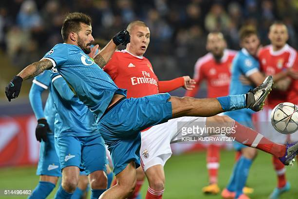 Zenit's Portuguese midfielder Danny vies for the ball with Benfica's Swedish defender Victor Lindelof during the secondleg round of 16 UEFA Champions...