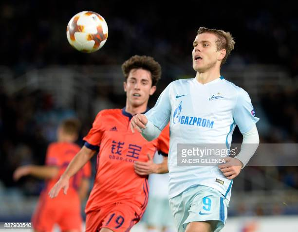 Zenit's Russian forward Aleksandr Kokorin challenges Real Sociedad's Spanish defender Alvaro Odriozola during the UEFA Europa League group L football...