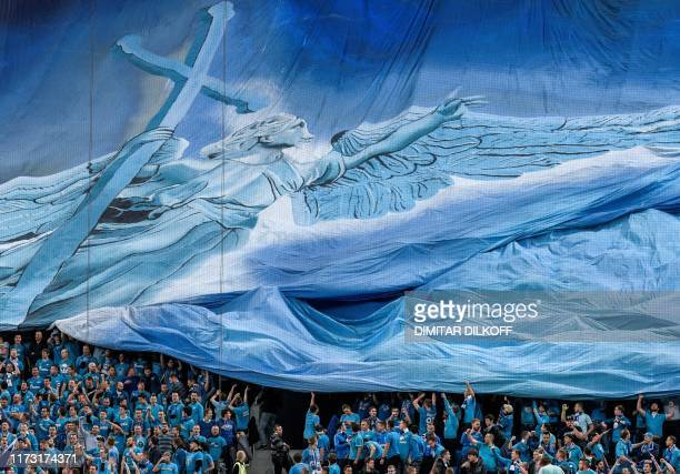 TOPSHOT Zenit's supporters hold a giant banner before the UEFA Champions League Group G football match between FC Zenit and Benfica at the Krestovsky...