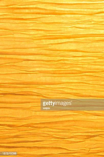 Zen-like wrinkled paper background backlit golden light