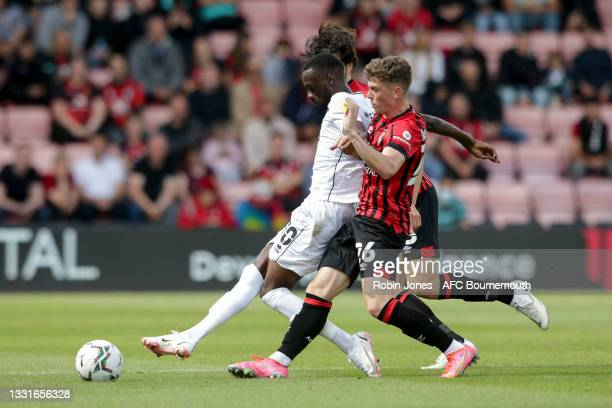 Zeno Ibsen Rossi and Gavin Kilkenny of Bournemouth close down Mo Eisa of MK Dons during the Carabao Cup 1st Round match between AFC Bournemouth and...