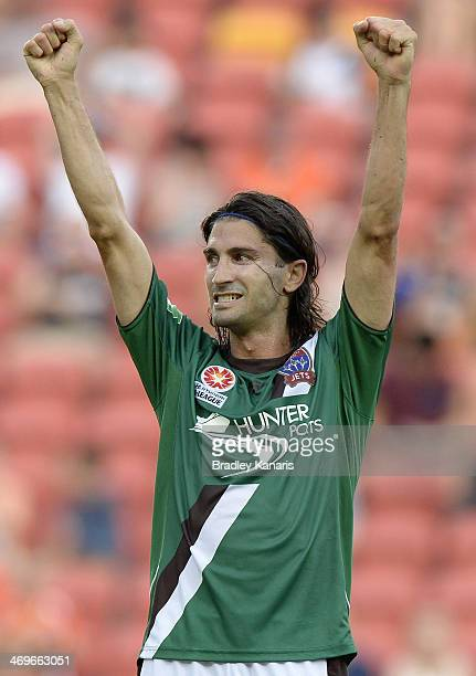 Zenon Caravella of the Jets celebrates victory after the round 19 A-League match between Brisbane Roar and the Newcastle Jets at Suncorp Stadium on...