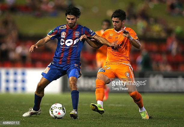 Zenon Caravella of the Jets contests the ball with Dimitri Petratos of the Roar during the round six ALeague match between the Newcastle Jets and...