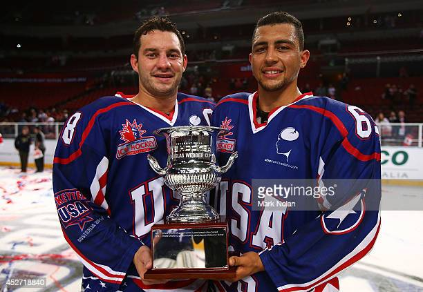 Zenon Konopka and Emerson Etem of the USA pose with the Douglas Webber Cup after winning the International Ice Hockey Series between the United...