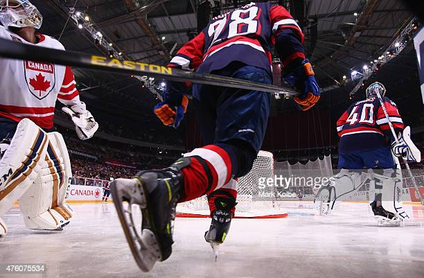 Zenon Konopka and Garret Sparks of the United States of America take to the ice for the third quarter during the 2015 Ice Hockey Classic match...
