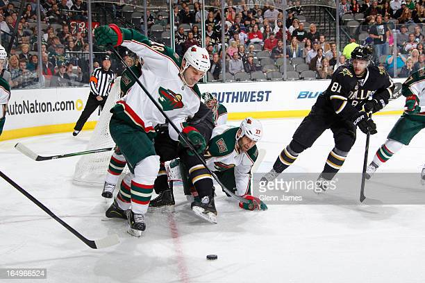Zenon Konopka and Mike Rupp of the Minnesota Wild try to keep a puck out of their net against Tomas Vincour and the Dallas Stars at the American...