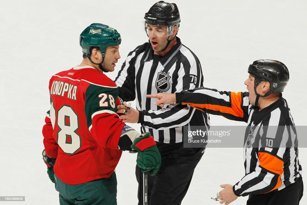 Zenon Konopka #28 of the Minnesota Wild reacts after being called for an unsportsmanlike conduct penalty against the Vancouver Canucks during the game on March 10, 2013 at the Xcel Energy Center in Saint Paul, Minnesota.