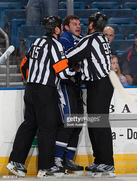 Zenon Konopka of the Tampa Bay Lightning argues with referees Stephane Auger and Jonny Murray during the first period against the Atlanta Thrashers...