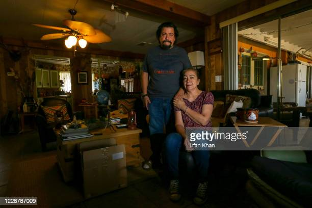 Zenon Mayorga, left, and Martha Mayorga in the living room of their home in Juniper Hills on Saturday, Sept. 26, 2020 in Little Rock, CA.