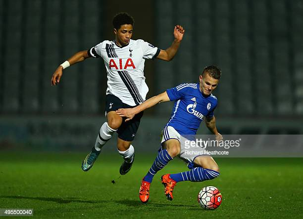 Zenon Stylianides of Spurs tussles with Florian Pick of Schalke during the Barclays U21 Premier League International Cup match between Tottenham...
