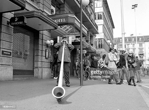 CONTENT] zenza bronica etr ilford hp5 rodinal zurich demonstration march street alphorn street music filmphotography analogphotography