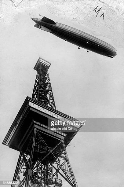 Zeppelin, a type of rigid airship, at the Radio Tower Berlin , bottom view - ca. 1928- Photographer: Alfred Gross- Published by: 'Berliner...