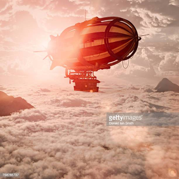 Zeppelin flying above clouds
