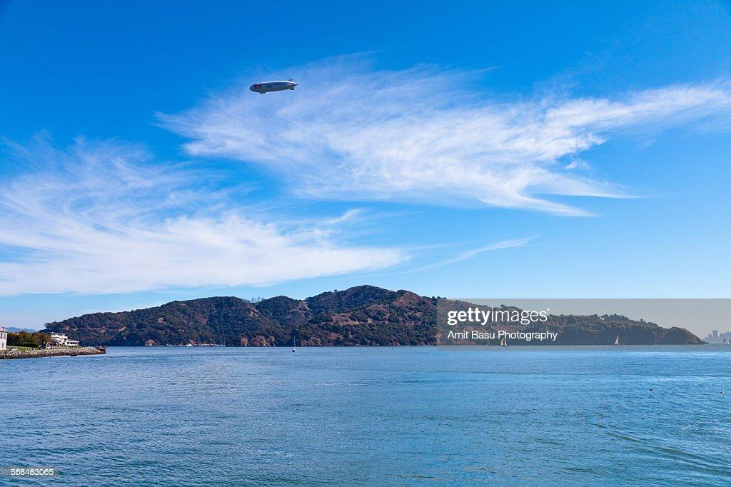 Zeppelin flying over Angel Island, California : Stock Photo
