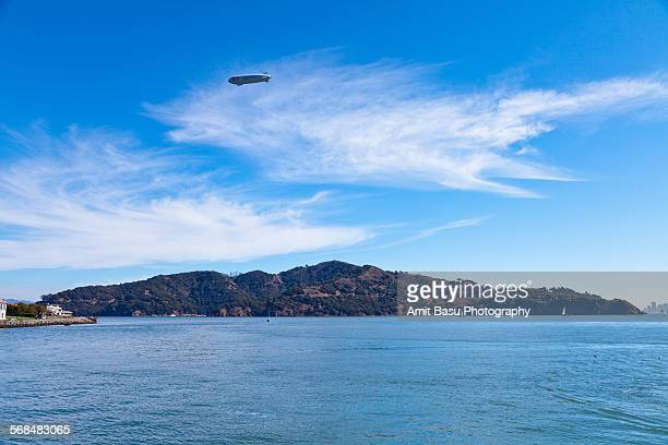 zeppelin flying over angel island, california - angel island stock photos and pictures