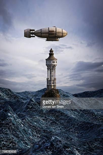 Zeppelin hovering over lighthouse on rock in ocean
