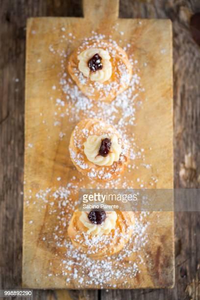 zeppole, apulian pastries - zeppole foto e immagini stock