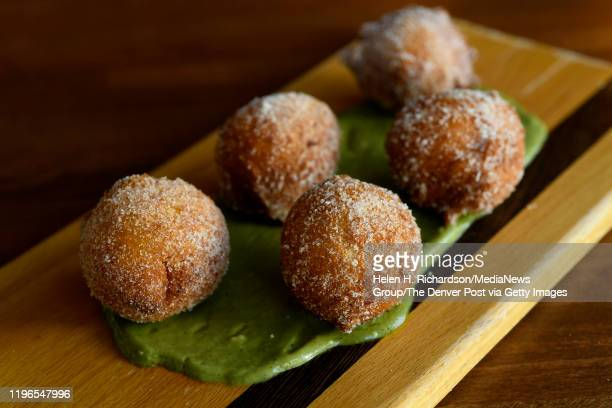 Zeppole are Sicilian ricotta donuts served with caradmom sugar and pistachio mousse at Spuntino Restaurant on June 27 2019 in Denver Colorado