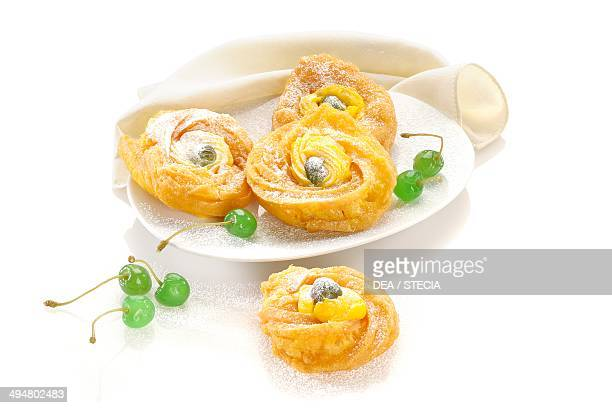Zeppole di San Giuseppe from Naples carnival biscuits filled with custard and decorated with candied cherries Campania Italy