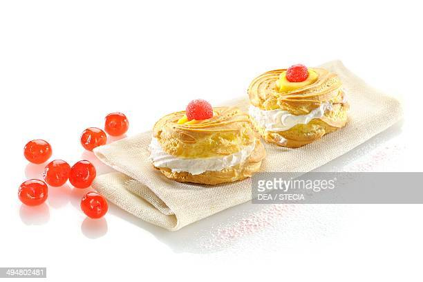 Zeppole di San Giuseppe from Puglia carnival biscuits filled with whipped cream and decorated with candied cherries Apulia Italy