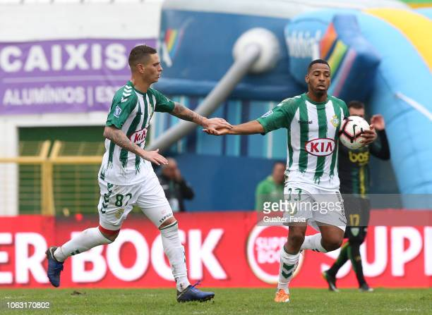 Zequinha of Vitoria FC celebrates with teammate Allef Andrade of Vitoria FC after scoring a goal during the Taca da Liga match between Vitoria FC and...