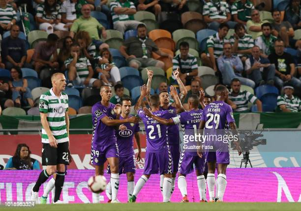 Zequinha of Vitoria FC celebrates with teammates after scoring a goal during the Liga NOS match between Sporting CP and Vitoria FC at Estadio Jose...