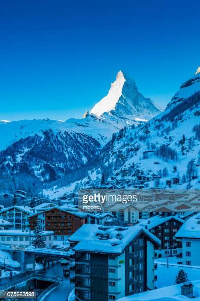 zermatt town with matterhorn peak in mattertal, switzerland, at dawn - zermatt stock pictures, royalty-free photos & images