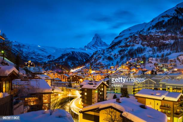 zermatt town with matterhorn peak in mattertal, switzerland, at dawn - european alps stock photos and pictures