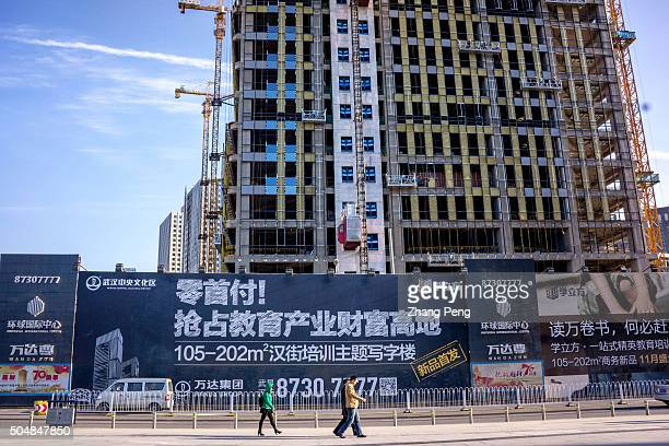 A zero down payment advertisement outside an office building construction site in downtown According to the newest survey by the Asian Association...