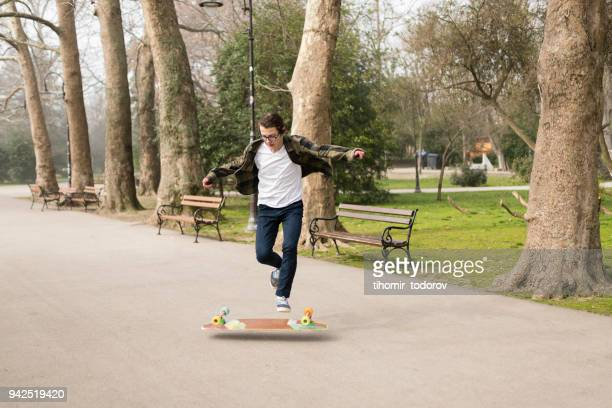 zero gravity for teenage skater - anti gravity stock photos and pictures
