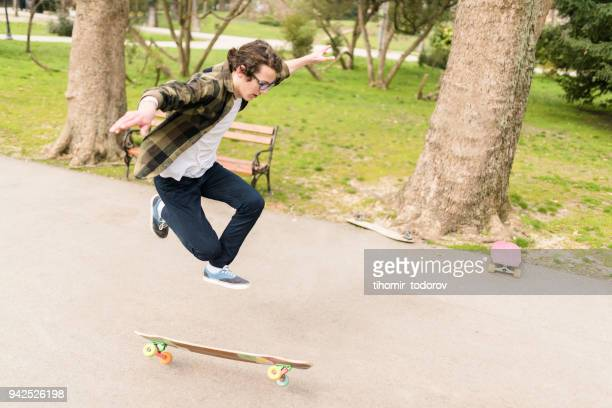 zero gravity for this teenage skater - anti gravity stock photos and pictures