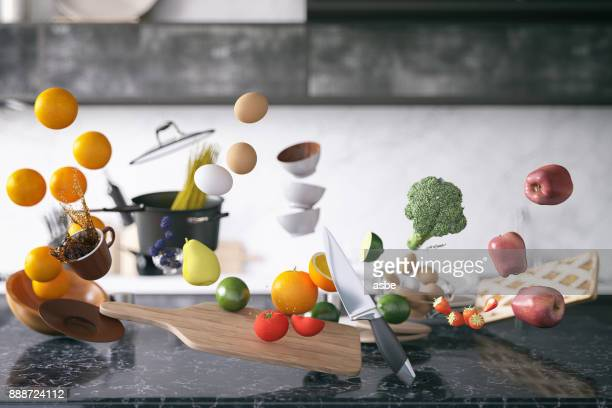 zero gravity in kitchen - cooking utensil stock photos and pictures