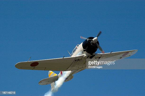zero - japanese fighter in flight - mitsubishi a6m zero stock photos and pictures