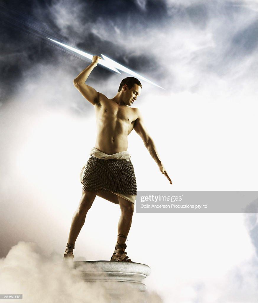 Zeus Holding Lightning Bolt Stock Photo