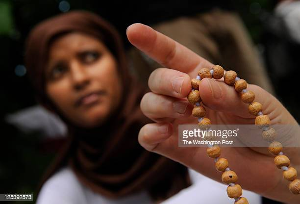 Zeyneb Ibrahim left sits next to Ann Divecha right as she holds chanting beads during a program entitled 'The Experience of Mantra Meditation' at the...