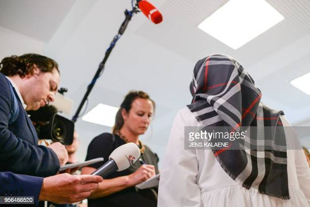 Zeynep Cetin from the Network against Discrimination and Islamophobia talks with journalists on May 9 2018 at court in Berlin after the court barred...