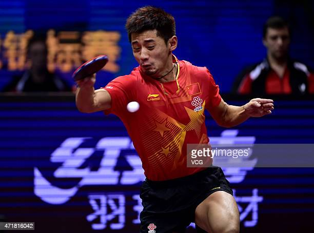 Zhagn Jike of China competes against Vladimir Samsonov of Belarus during the fourth round of men's singles match on day six of the 2015 World Table...