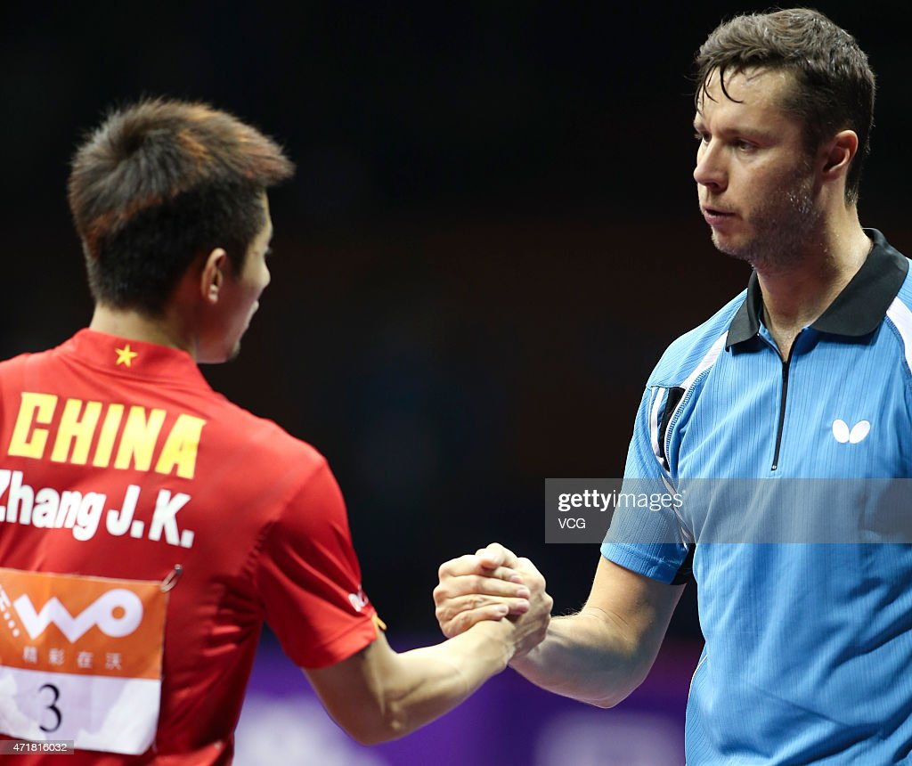 Zhagn Jike of China shakes hands with Vladimir Samsonov of Belarus during the fourth round of men's singles match on day six of the 2015 World Table Tennis Championships at the Suzhou International Expo Center on May 1, 2015 in Suzhou, China.
