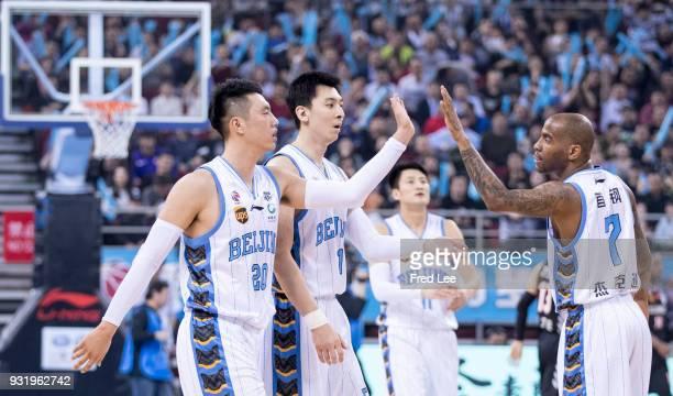 Zhai XiaochuanZhe Ji and Aaron Jackson of Beijing Ducks in action during the 2017/2018 CBA League match between Beijing Duck and Liaoning Benxi Steel...