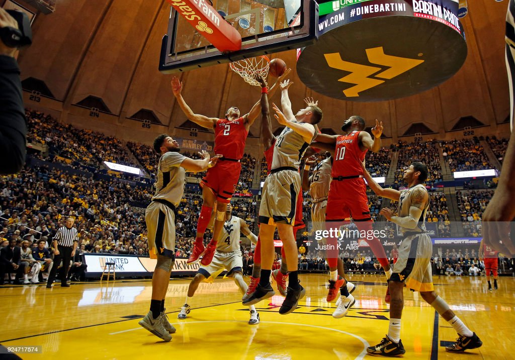 Zhaire Smith #2 of the Texas Tech Red Raiders and Logan Routt #31 of the West Virginia Mountaineers battle for a rebound at the WVU Coliseum on February 26, 2018 in Morgantown, West Virginia.
