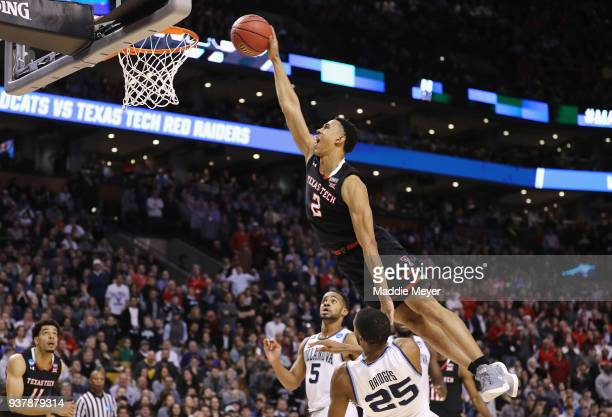 Zhaire Smith of the Texas Tech Red Raiders attempts to dunk the ball against Mikal Bridges of the Villanova Wildcats during the second half in the...