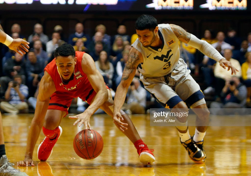 Zhaire Smith #2 of the Texas Tech Red Raiders battles for the ball against James Bolden #3 of the West Virginia Mountaineers at the WVU Coliseum on February 26, 2018 in Morgantown, West Virginia.