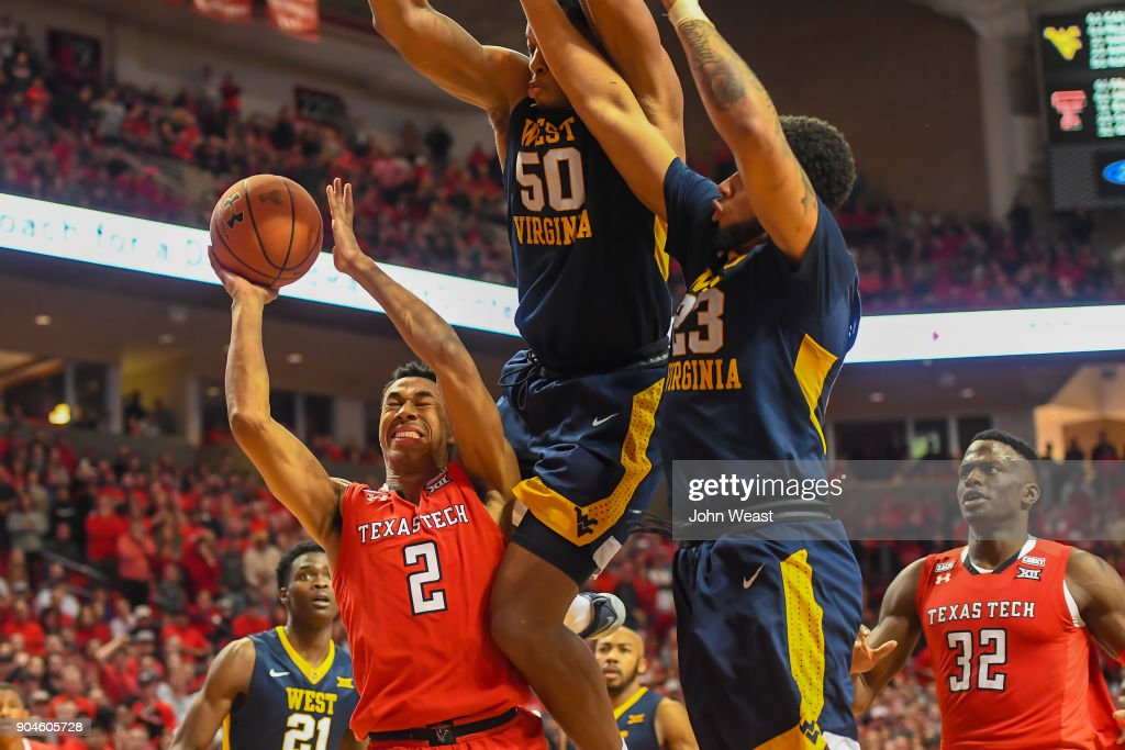Zhaire Smith #2 of the Texas Tech Red Raiders goes to the basket and is fouled by Sagaba Konate #50 of the West Virginia Mountaineers during the game on January 13, 2018 at United Supermarket Arena in Lubbock, Texas.