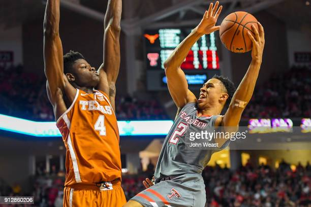 Zhaire Smith of the Texas Tech Red Raiders goes up for a shot against Nohamed Bamba of the Texas Longhorns during the game on January 31 2018 at...